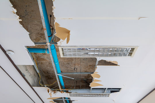 repair leak water pipe on gypsum ceiling interior office building