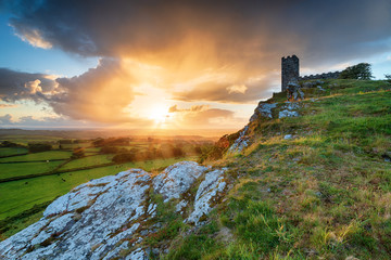 Wall Mural - Dramatic sunset over the chapel on Brentor