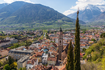 Panorama view on skyline of main District of City Meran with Church, Vegetation and Mountains. Merano. Province Bolzano, South Tyrol, Italy. Europe.