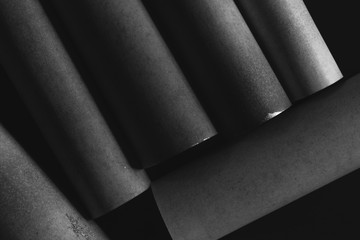 Abstract background, cylindrical gray elements on black