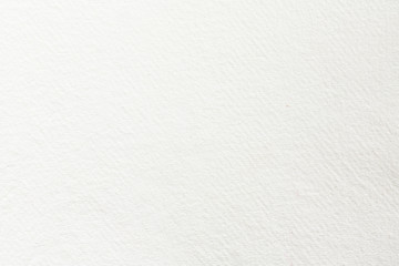White paper texture for use as a background. High quality photography.