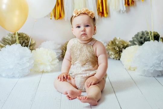 Little happy toddler girl celebrating first birthday