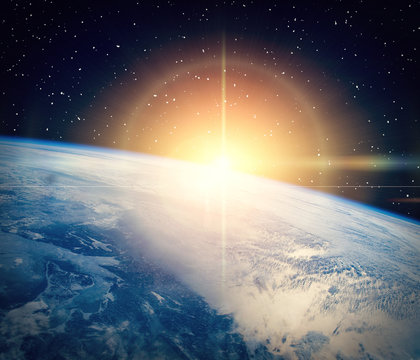 Gorgeous space panorama with the sunrise over the Earth. The elements of this image furnished by NASA.
