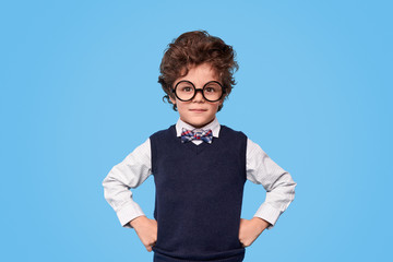 Photo sur Toile Cute nerdy schoolboy looking at camera