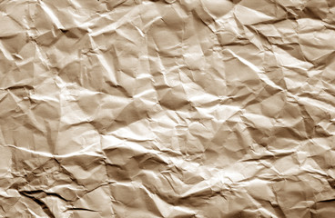 Crumpled sheet of paper with blur effect in brown color.