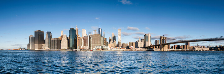 Manhattan skyline panorama with blue sky as background image