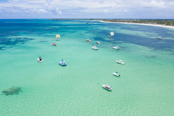 Fototapete - Aerial view from drone on tropical coastline with palm trees and speed boats