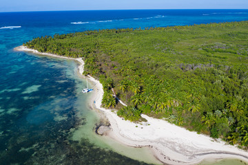 Fototapete - Aerial view from drone on tropical coast with coconut palm trees and speed boats