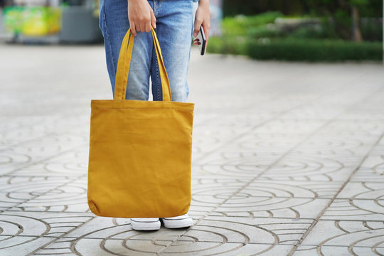 woman with fabric bag for shopping at Department Store
