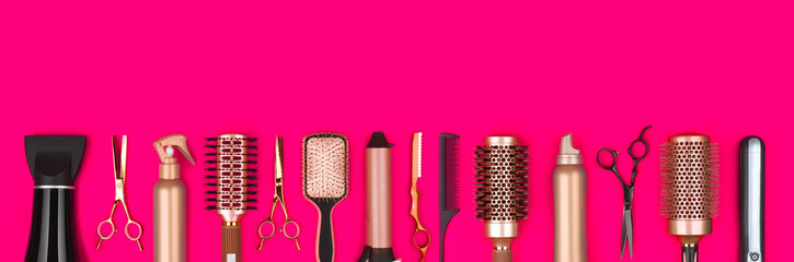Professional hair dresser tools on red background with copy space