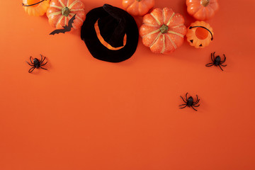 Pumpkins decorations on orange paper