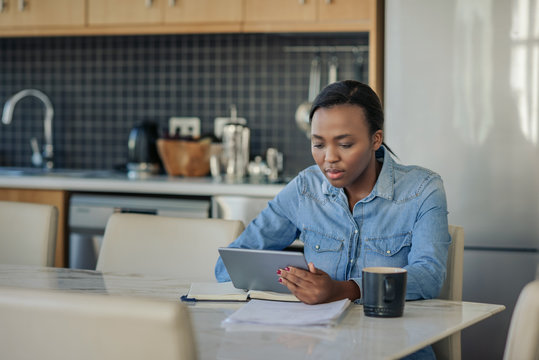 Young African American woman using a digital tablet at home