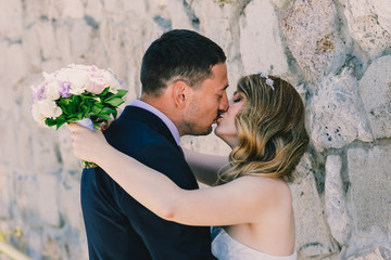 Romantic couple on their wedding day kissing