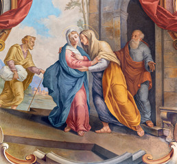 Wall Mural - COMO, ITALY - MAY 8, 2015: The fresco of Visitation fresco in church Santuario del Santissimo Crocifisso by Gersam Turri (1927-1929).