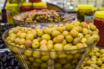 Fresh green olives for sale at local market