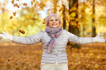 old age, retirement and season concept - happy senior woman enjoying beautiful autumn outdoors