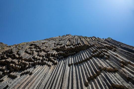 A scenic view of the basalt columns, grottoes, rock and lava formations. Basalt Formation , Garni gorge , Symphony of the Stones, Basalt column formations , Armenia Garni.