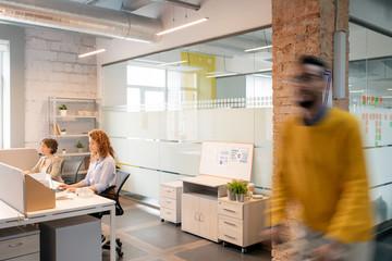 People working in modern open-space office