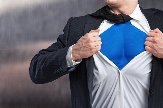 Businessman tears shirt on himself to show