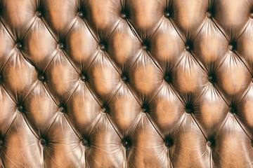 Pattern of chesterfield buttoned brown leather