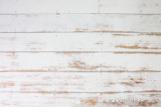 White wooden floorboards. Distressed worn floorboard background painted white