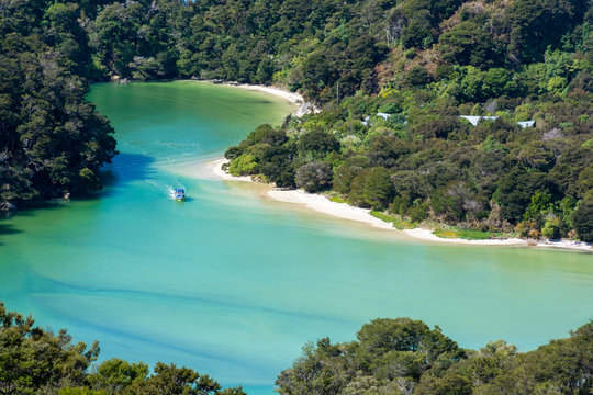 Amazing view of boat in a turquoise lagoon in Abel Tasman National Park, New Zealand