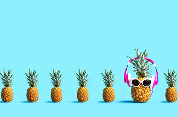 One out unique pineapple wearing headphones on a solid color background Wall mural