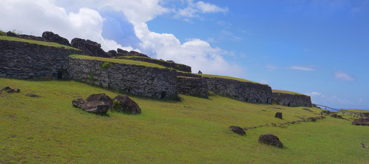AERIAL: Scenic drone shot of old stone houses on picturesque Easter Island.