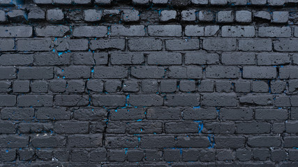 Black brick wall. painted black with shades of blue