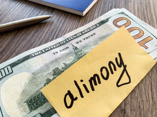 Payments alimony. Pile Dollars with sign alimony and money. Divorce and separation concept.