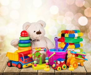 Bear and collection colorful toys on wooden desk