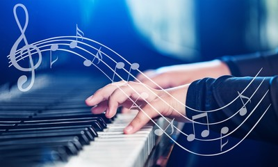 Close up of a musician playing a piano keyboard