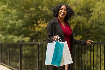 Beautiful African American woman walking and shopping.