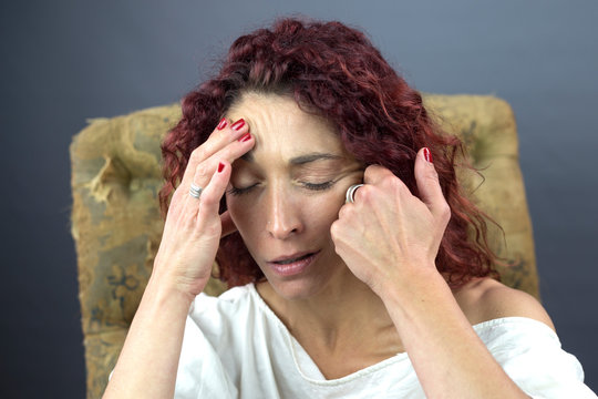 Woman with migraine headaches.