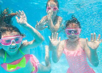 little girls  swimming  in pool