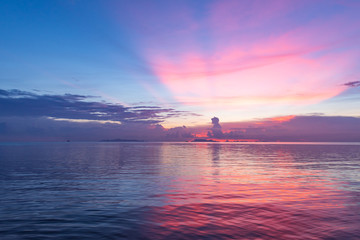 Beautiful tropical pink blue sea  sunset and yellow clouds background