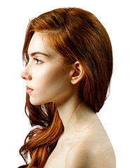 Side view on young redhead woman with serious look