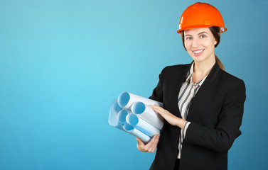 Portrait of a young female engineer wearing  a safety helmet at work site