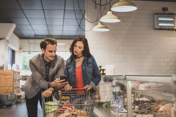 Couple doing weekly grocery shop together