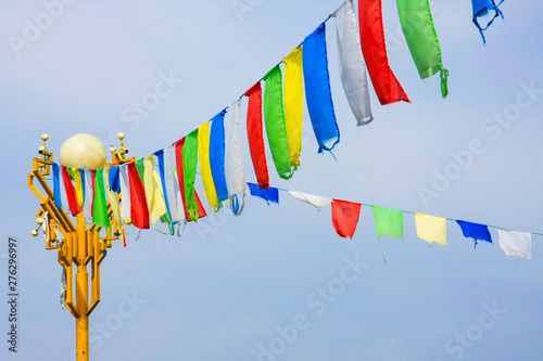 Buddhist prayer flags darding with mantras inscribed on them