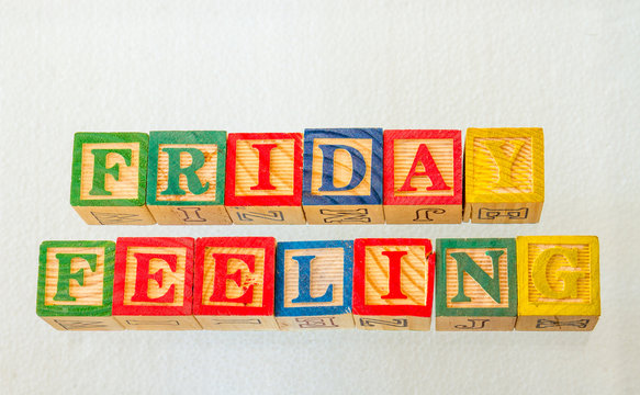 The term friday feeling visually displayed on a clear background using colorful wooden toy blocks image in landscape format