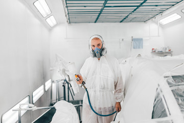 Portrait of a man working in a paint chamber.