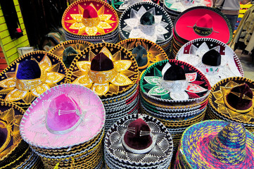 A stack of Sombreros in different sizes for sale in a Mexico City shop.