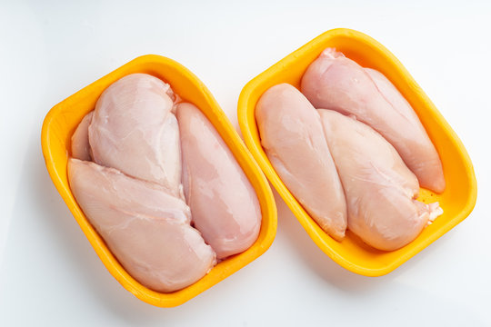 Raw chicken fillet package isolated on white background.