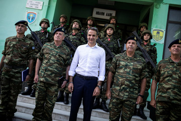 Main opposition New Democracy conservative party leader Mitsotakis poses for a picture with Greek military personnel at a military outpost next to the Greek-Turkish borders, near the village of Kastanies
