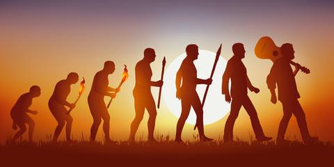 Concept de la pensée baba cool des sixties, avec le symbole de l'évolution de Darwin qui aboutit sur un homme hippie marchant en tenant sa guitare sur son épaule.