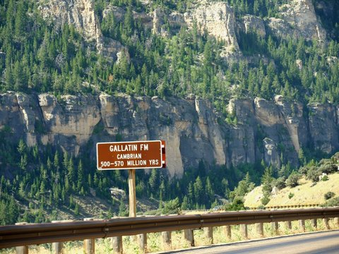 Roadside sign of Gallatin or geologic formations dating back 500 to 570 million years back at Bighorn Mountains in Wyoming.
