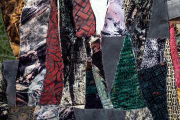 Dark colored colorful fabric texture of a jacket.The horizontal shot used as an abstract...