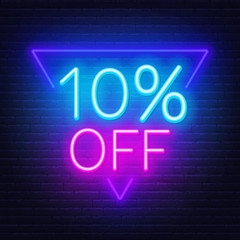10 percent off neon lettering on brick wall background