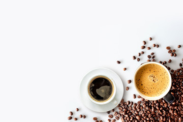 hot espresso and coffee bean on white table with soft-focus and over light in the background. top...